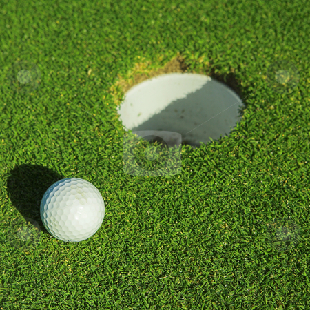 Golfer #38 stock photo, A golf ball on a green by Sean Nel