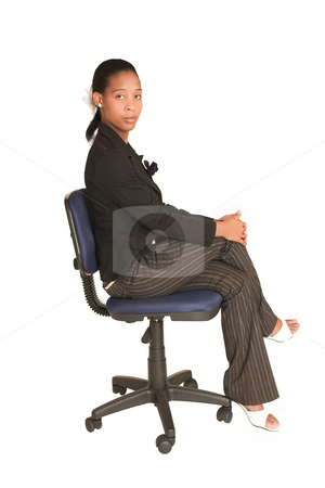 Mida Matsimela #20 stock photo, African business woman dressed in black jacket. Sitting on office chair by Sean Nel