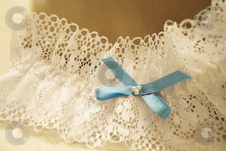 Wedding #35 stock photo, Close-up of a wedding garter.  Shallow D.O.F by Sean Nel