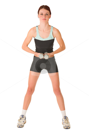 Gym #159 stock photo, Woman in gym wear standing still with weights in her hands. by Sean Nel