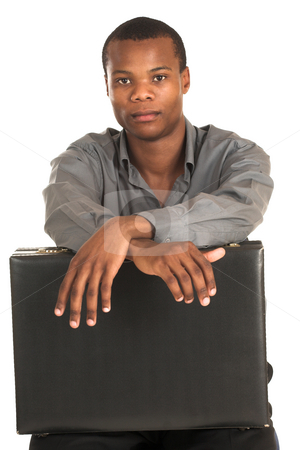 Businessman #143 stock photo, Businessman with grey shirt, sitting on a chair, holding a black leather suitcase. by Sean Nel