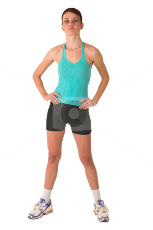 Gym #108 stock photo, Woman is looking serious in gym wear, with her hands on her hips. by Sean Nel