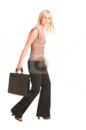 Business Woman #308 stock photo, Blond business woman dressed in black trousers and a beige shirt. Walking, carrying a black leather suitcase.  Movement on right foot. by Sean Nel