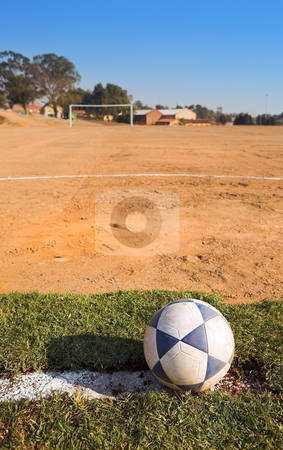Rural soccer field stock photo, Dirty soccer ball on a rural football field by Sean Nel