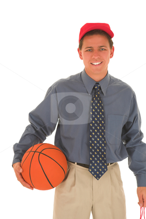 Coach #24 stock photo, Man wearing a red cap holding a basket ball in one hand. by Sean Nel