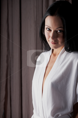 Intimate young lovers stock photo, Young adult Caucasian woman in a white gown, undressing as a part of foreplay by Sean Nel