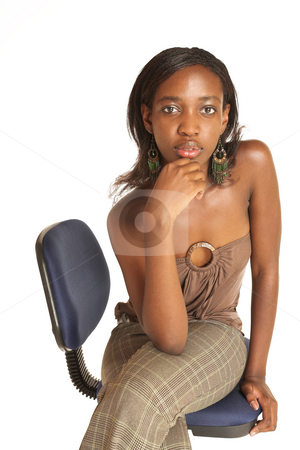 Cynthia Akva #1 stock photo, African business woman dressed in neutral coloured clothes. Sitting on office chair. by Sean Nel