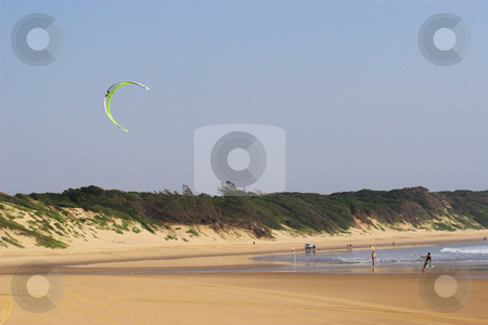 Sudwana #14 stock photo, A beach in Sudwana, South Africa with people walking, and flying kites. by Sean Nel