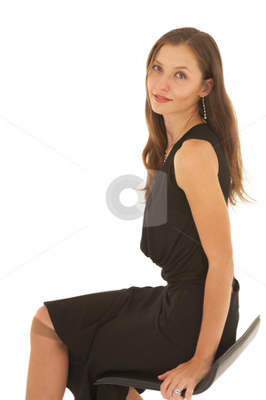 Beautiful Caucasian businesswoman stock photo, Portrait of a beautiful young Caucasian businesswoman with long hair sitting on the office chair on white background. NOT ISOLATED by Sean Nel