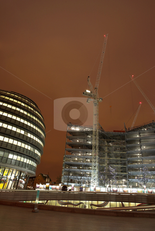 London #49 stock photo, Office block and construction site at nighttime. by Sean Nel