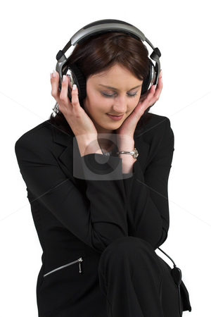 Luzaan Roodt #11 stock photo, Woman in formal black suit, headset on head, listening to music - eyes closed by Sean Nel