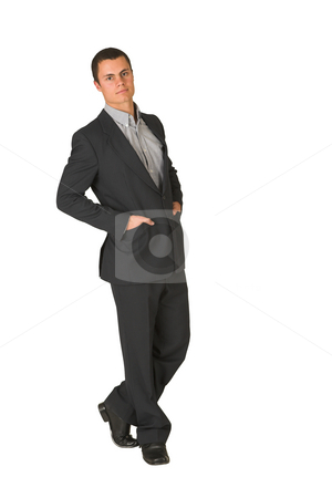 Businesswoman #229 stock photo, Businessman wearing a suit and a grey shirt.  Standing  with both hands in his pockets, looking serious. by Sean Nel