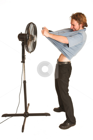 David Badenhorst #11 stock photo, Man with blue shirt cooling down in front of a fan. by Sean Nel