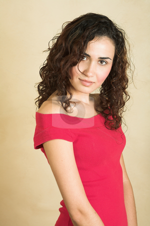 Young adult woman stock photo, Portrait of a beautiful young adult Caucasian woman with light skin and curly brown hair, brown eyes and pink lips, wearing a red top by Sean Nel