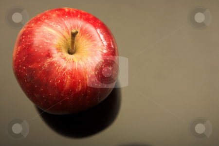 Fresh red apple stock photo, Fresh red apple on a black glass backdrop with copy space by Sean Nel