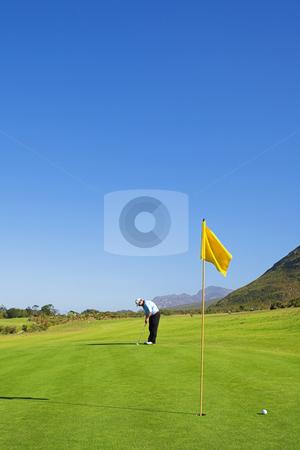 Golfer #44 stock photo, A golfer playing golf on a green. by Sean Nel