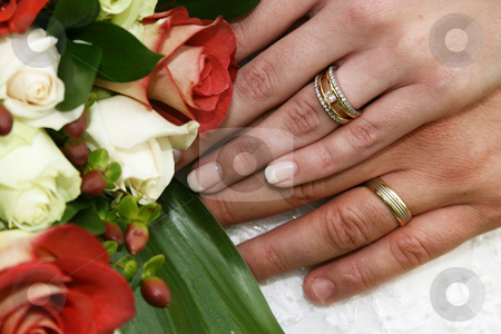 Wedding rings stock photo, Wedding rings and flowers by Sean Nel
