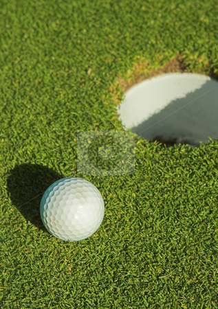 Golfer #37 stock photo, A golf ball on a green. by Sean Nel