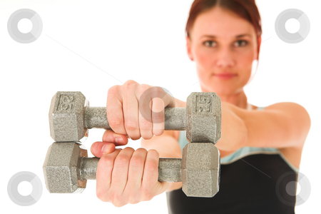 Gym #6 stock photo, A woman in gym clothes, holding weights out in front of her.  Shallow DOF  by Sean Nel