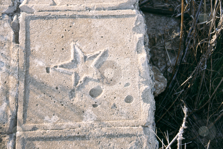 Star shaped tile stock photo, Star shaped embossing on tile found in broken down building by Sean Nel