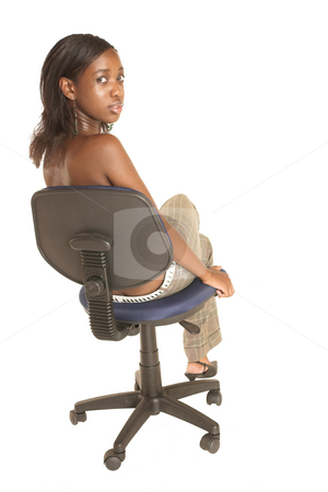 Cynthia Akva #8 stock photo, African business woman dressed in neutral coloured clothes. Sitting on office chair by Sean Nel