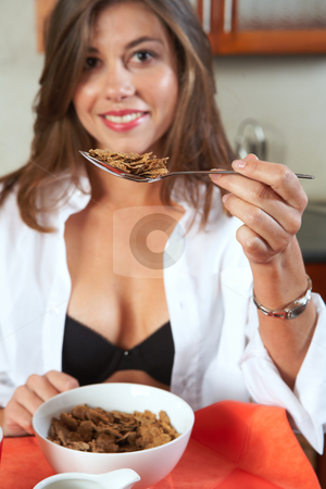 Sexy brunette eating breakfast stock photo, Sexy young adult brunette woman in black lingerie eating breakfast and drinking coffee in her kitchen. Shallow Depth of Field, focus on spoon by Sean Nel