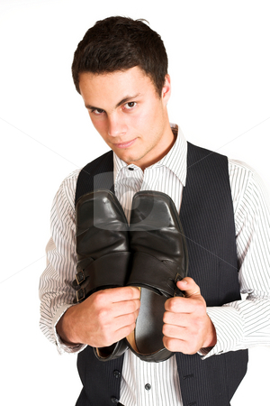 Businessman #111 stock photo, Businessman standing, holding his shoes. by Sean Nel
