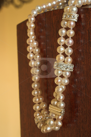 String of Pearls necklace stock photo, Double pearl necklace with silver clasps and spacers (shallow Depth of Field - Focus on front string) by Sean Nel