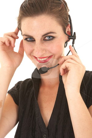 Sexy brunette businesswoman stock photo, Sexy young adult Caucasian businesswoman in a tight black sexy blouse on a white background with a telemarketer telephone headset by Sean Nel