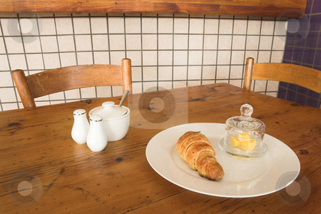 Lunch #25 stock photo, Croissant and butter on a plate on table by Sean Nel