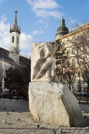 Statue in Vienna stock photo, Pigeons around a half finished statue in Vienna, Austria - Editorial by Sean Nel