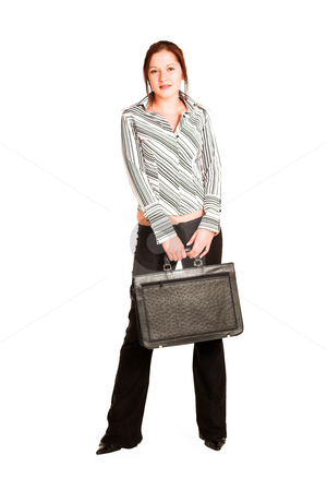 Business Woman #338 stock photo, Business woman with brown hair, dressed in a white shirt with black stripes. Holding a black leather suitcase by Sean Nel