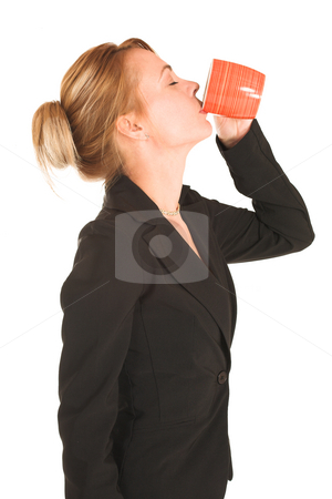 Businesswoman #253 stock photo, Blonde business lady in formal black suit. Drinking out of  a mug - eyes closed. by Sean Nel