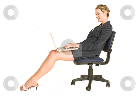 Laura Hopton #1 stock photo, Business woman on office chair with Laptop on her lap - looking down by Sean Nel
