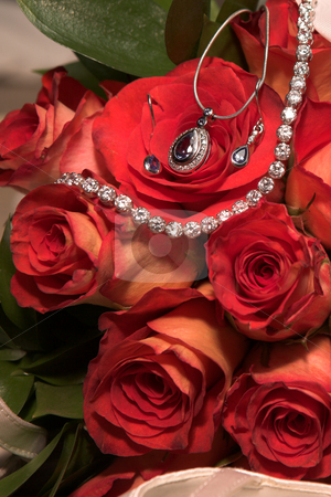 Jewelry in Wedding bouquet stock photo, Expensive Jewelry in red rose wedding bouquet by Sean Nel