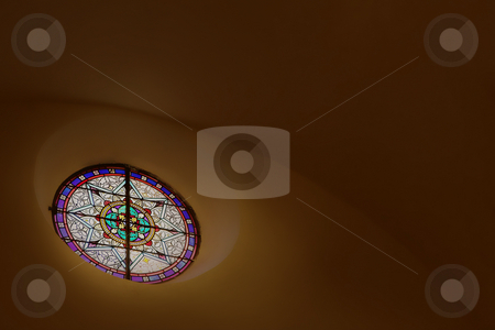 St Paul #19 stock photo, Stained glass window close to the roof inside a chapel by Sean Nel