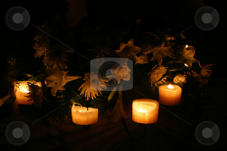 Candles and flowers stock photo, Flowers and candles on the side of a table by Sean Nel