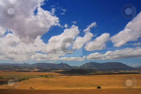 Haybales #4 stock photo, Farming fields with mountains in the background by Sean Nel