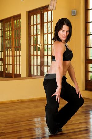 Dancer #3 stock photo, A Female Dancer practicing in her studio by Sean Nel