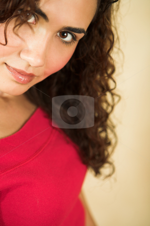 Young adult woman stock photo, Portrait of a beautiful young adult Caucasian woman with light skin and curly brown hair, brown eyes and pink lips, wearing a red top. Shallow Depth of Field - focus on red lips by Sean Nel