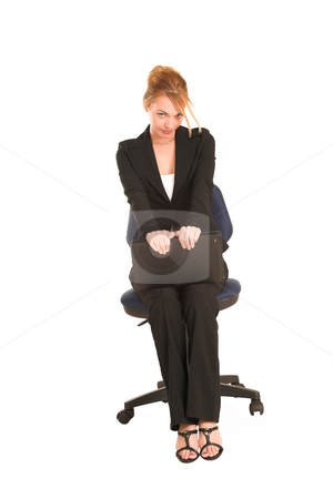 Businesswoman #259 stock photo, Blonde business lady in formal black suit. Sitting on office chair with suitcase on her lap by Sean Nel