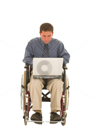 Businessman #133 stock photo, Man working on laptop sitting in a wheelchair. by Sean Nel