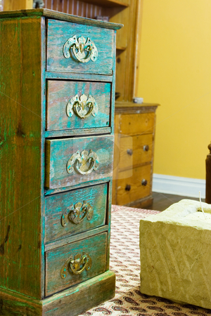 Table setting #4 stock photo, Miniature turquois chest of Drawers by Sean Nel