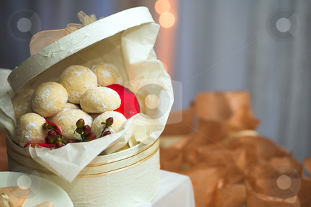 Caramel cookie confectionery stock photo, Confectionery and cookies in white gift boxes with ribbons as wedding guest gifts and table decorations by Sean Nel