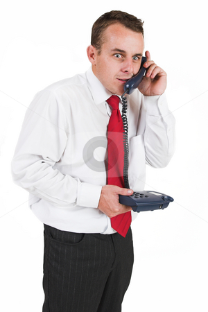 Tollie Booysen #20 stock photo, Businessman in black trousers, white shirt and red tie. Talking on phone by Sean Nel