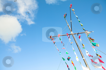 Flags of the world stock photo, Various flags of various countries displayed together on a signal mast of a ship by Sean Nel