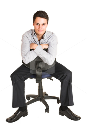 Businessman #102 stock photo, Businessman sitting on an office chair by Sean Nel