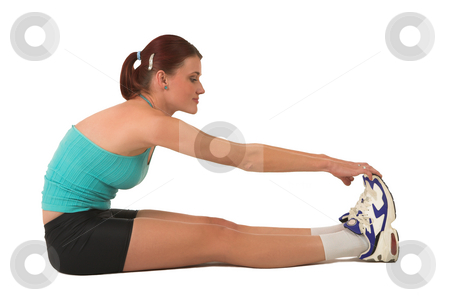 Gym #131 stock photo, Woman sitting and stretching. by Sean Nel