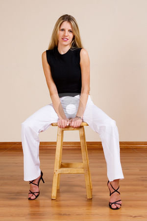 Woman #15 stock photo, Beatiful blonde woman sitting on a barstool by Sean Nel
