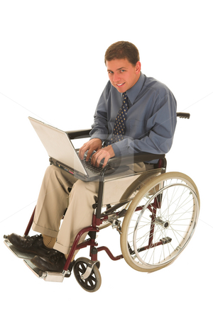 Businessman #137 stock photo, Businessman sitting in a wheelchair working on laptop by Sean Nel